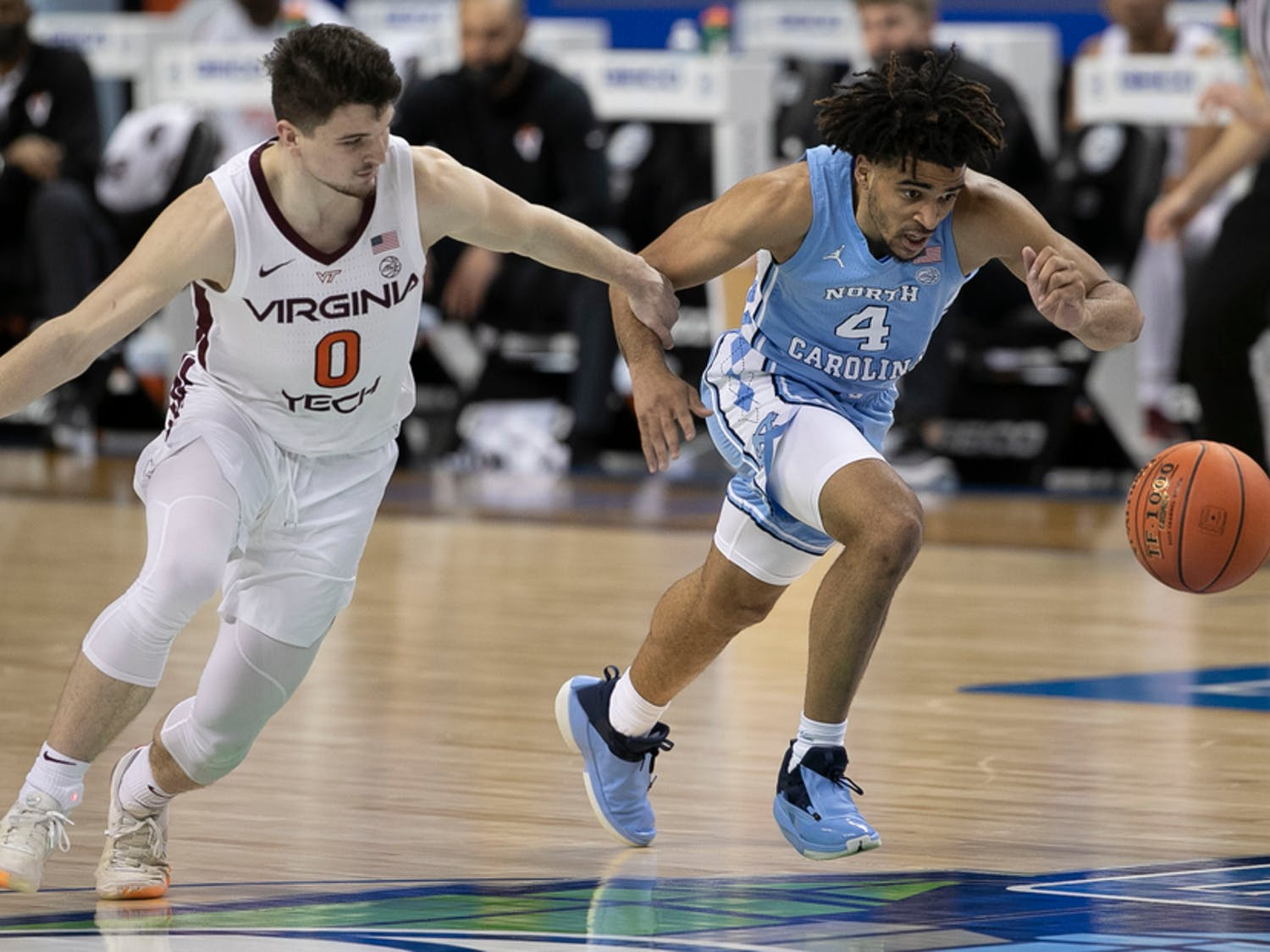 Virginia Tech's sophomore guard Hunter Cattoor defends against UNC freshman guard RJ Davis in the ACC Tournament Quarterfinals on Thursday, March 11, 2021 in the Greensboro Coliseum. The Tar Heels beat the Hokies 81-73. Photo courtesy of Robert Willett/The News & Observer.