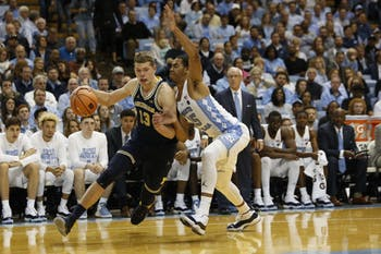 North Carolina forward Garrison Brooks (15) guards Michigan's Moritz Wagner (13) during Wednesday night's game in the Smith Center.