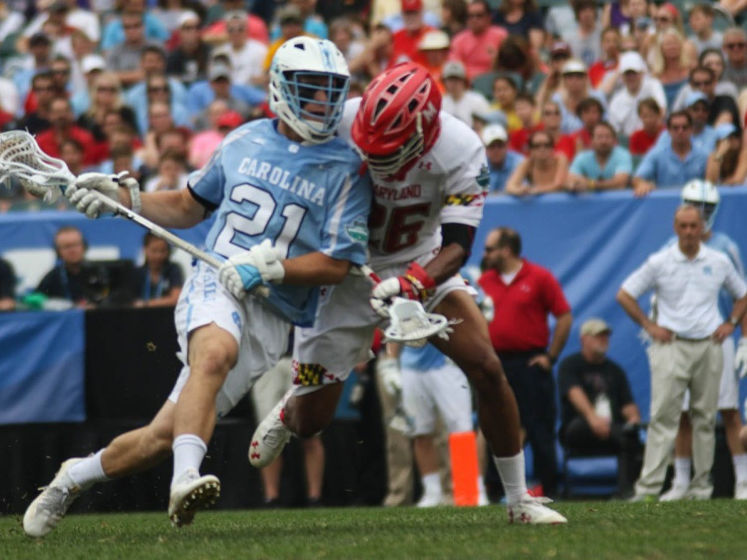 UNC midfielder Michael Tagliaferri (21) fights off a Maryland defender. The unseeded North Carolina men's lacrosse team defeated No. 1 Maryland 14-13 in overtime to claim the program's first national championship since 1993 in Mayat Lincoln Financial Field in Philadelphia. North Carolina faces Maryland this Saturday at 11:30.