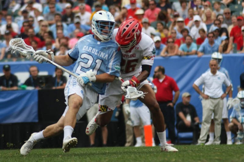 UNC midfielder Michael Tagliaferri (21) fights off a Maryland defender. The unseeded North Carolina men's lacrosse team defeated No. 1 Maryland 14-13 in overtime to claim the program's first national championship since 1993 in May at Lincoln Financial Field in Philadelphia. North Carolina faces Maryland this Saturday at 11:30.