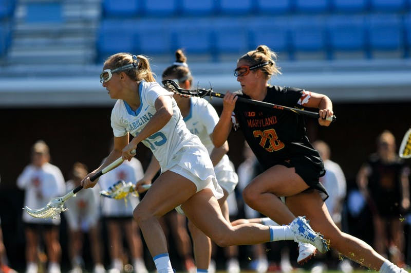 UNC junior midfielder Scottie Rose Growney (15) runs after the ball during the game against Maryland at Dorrance Field on Saturday, Feb. 22, 2020. No 1. UNC won against No 4. Maryland 19-6.