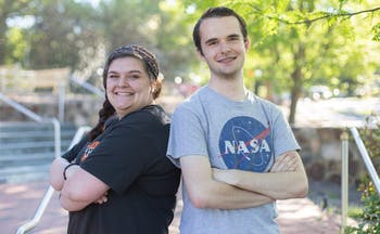 (From left to right) Mallory Ward, senior peace, war, and defense major, and Logan Anderson, first-year global studies major, pose on the steps of the FedEx Global Education Center, April 22, 2019. Ward, who is currently 20-years-old, started college at the same age as Ward who is currently 17-years-old.