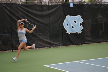 Sophomore Alexa Graham follows through after a hit against N.C. State on Feb. 21 at the Cone-Kenfield Tennis Center.