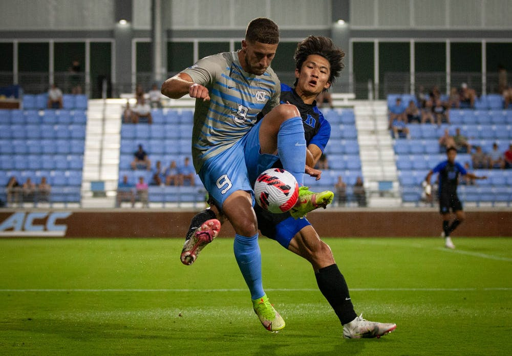 Fifth-year Santiago Herrera (9) defends the ball during the game against Duke at Dorrance Field on Sunday, Sept. 19. UNC lost 3-0.