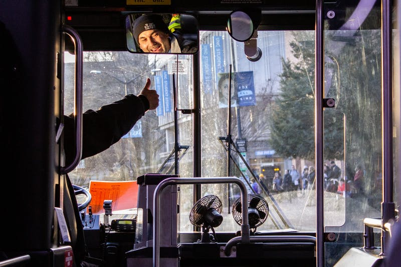 A Chapel Hill Transit bus driver on the U route gives a thumbs-up upon approaching the bus stop outside the UNC Student Stores on Wednesday, Jan. 22, 2020.