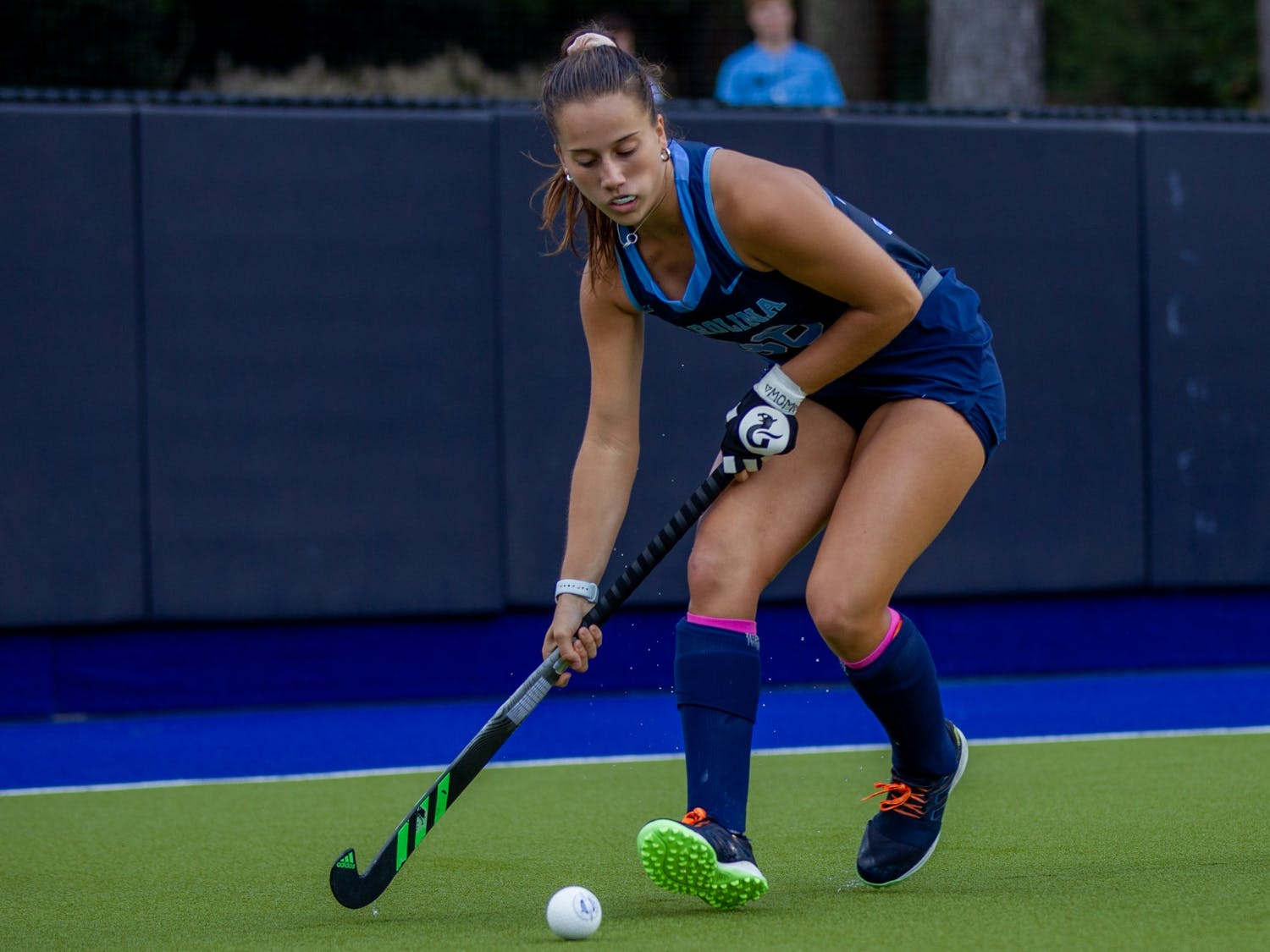 First-year forward Kennedy Cliggett (36) passes the ball at the hockey game against Louisville on Oct. 22 at the Karen Shelton Stadium. UNC lost 2-3 in overtime.