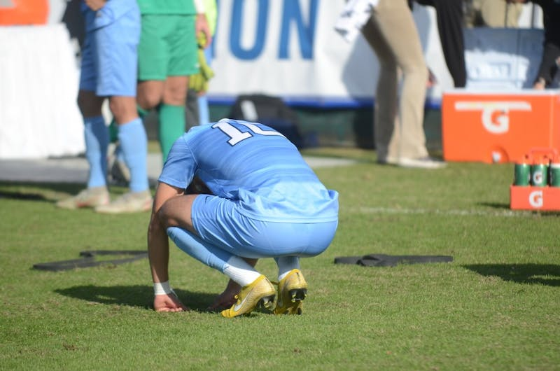 Forward Giovanni Montesdeoca (10) bends over in disappointment following Sunday's ACC Championship game at WakeMed Soccer Park. UNC lost to Louisville 1-0.