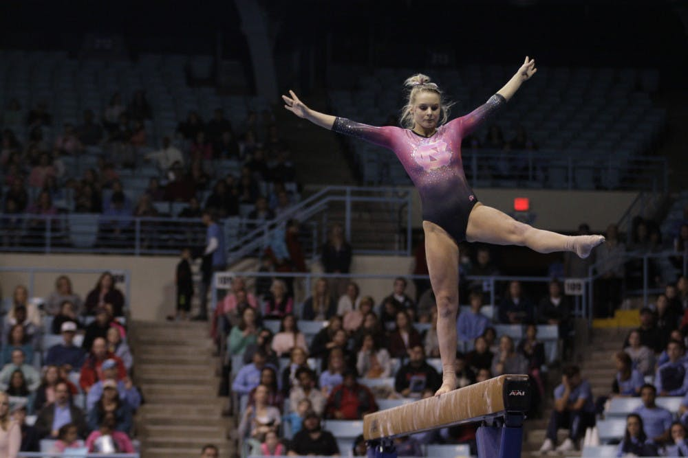 Stumbles on balance beam cost UNC gymnastics in narrow loss to N.C. State