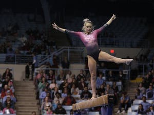 Sophomore Lily Dean competes on the balance beam against University of Oklahoma and Ball State University on Saturday, Jan. 19, 2019 in Carmichael Arena.