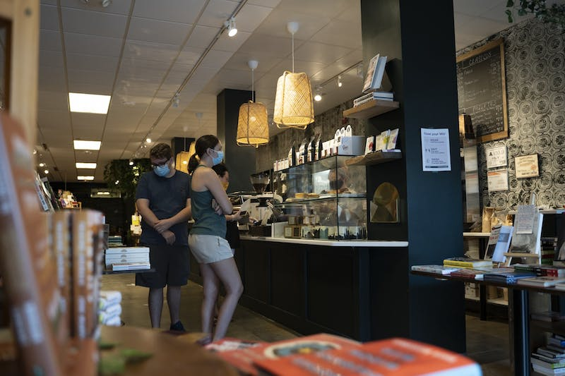 Customers wait in line at Epilogue Books Chocolate Brews, a Latinx-owned coffee shop and book store on Franklin Street, on Sunday, Aug. 9, 2020 before closing their indoor seating options.