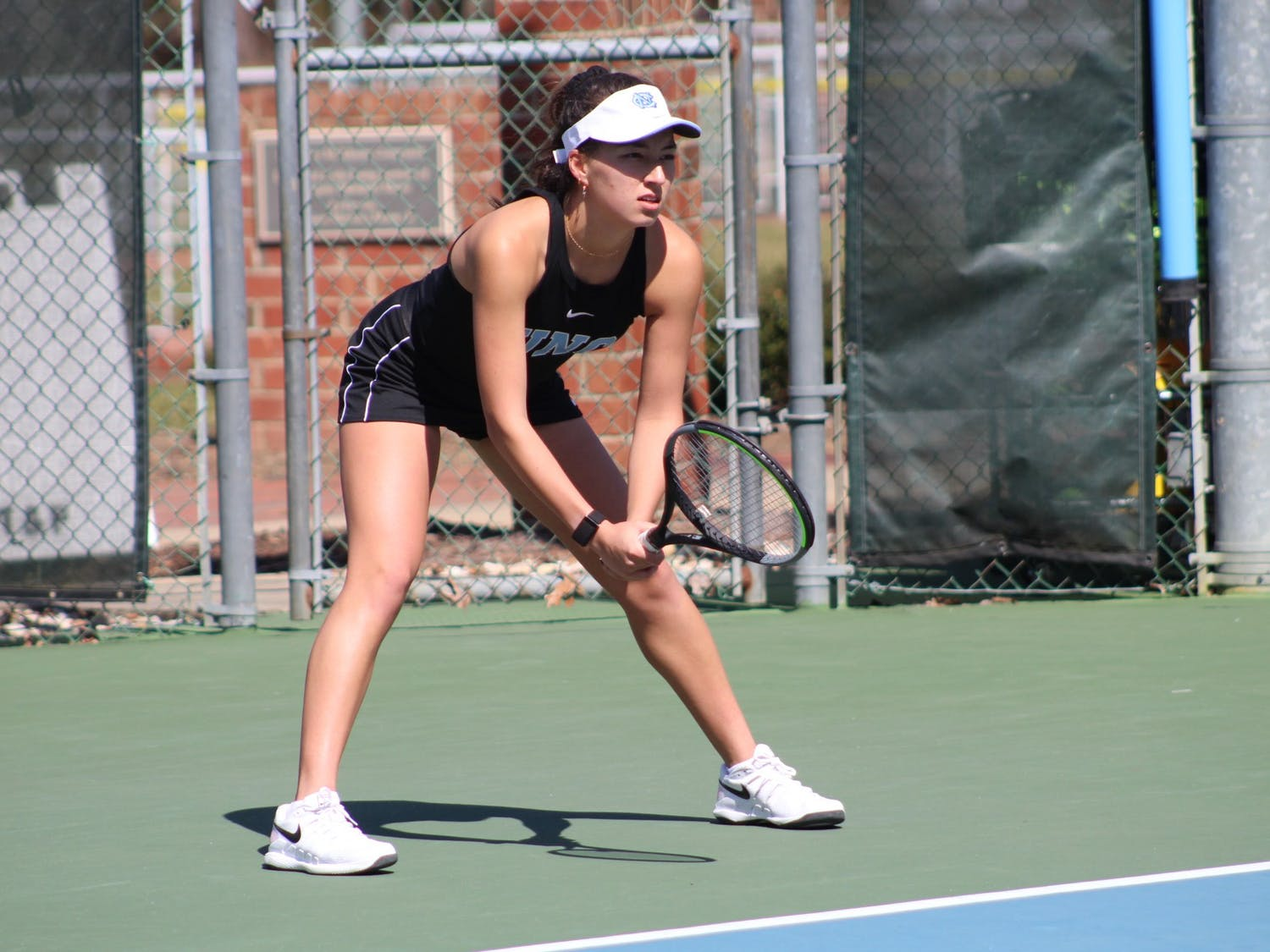 Reilly Tran prepares to return a serve during her doubles victory over Maya Tahan and Florencia Urrutia of the University of Miami on March 6, 2021.
