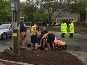 First responders on the scene assessing the injuries of the student.