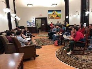 Graduate students met at the Campus Y to discuss the implications of the U.S. House tax bill. Photo courtesy of Ellie Rodriguez.