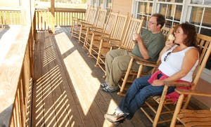 Paul Graf and Melissa Minor enjoy their Carolina Crunch and coffee toffee flavored ice cream on the porch of Maple View's ice cream shop.