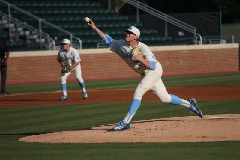 Freshman pitcher Rodney Hutchinson Jr. (48) throws out the opening pitch agains Campbell University on Wednesday.