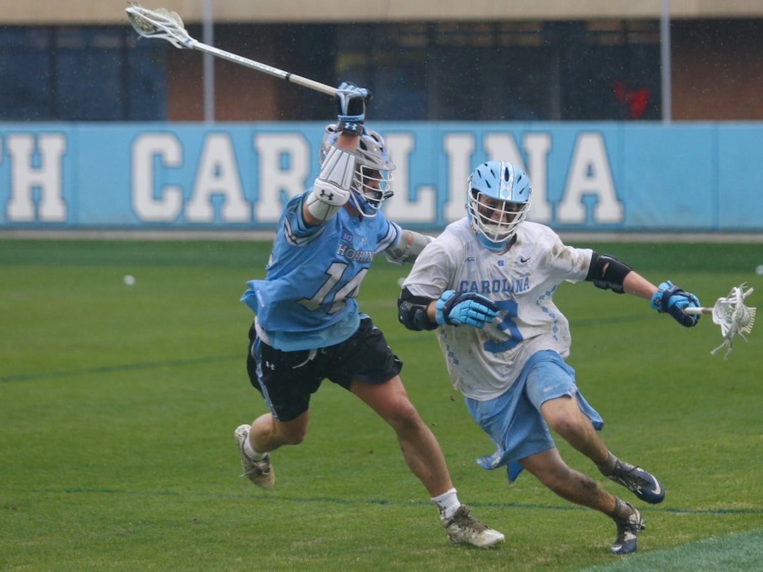 Midfielder William Perry (3) runs down the field during the game against Johns Hopkins in Kenan Memorial Stadium on Saturday, Feb. 23, 2019. UNC lost 10-11.