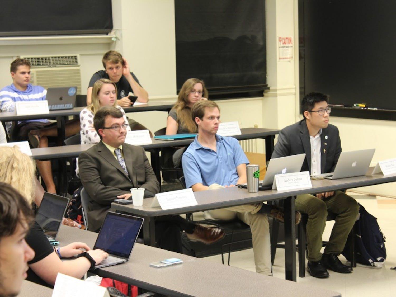 Junior Senator Tanner Henson (bottom left) of the Undergraduate Senate reacts to Senator Sosa Evbuomwan's response to events that occurred at the last meeting Tuesday, Oct. 16, 2018 in Gardner Hall.