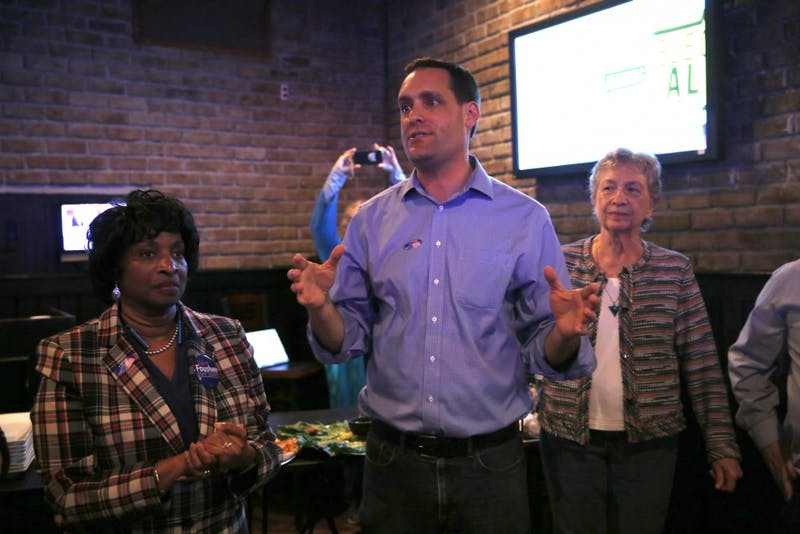 (From left to right) Valerie P. Foushee, Graig Meyer and Verla Insko speak to the audience at Orange County's Democratic Party's election party at Might as Well in Chapel Hill in November 2018.