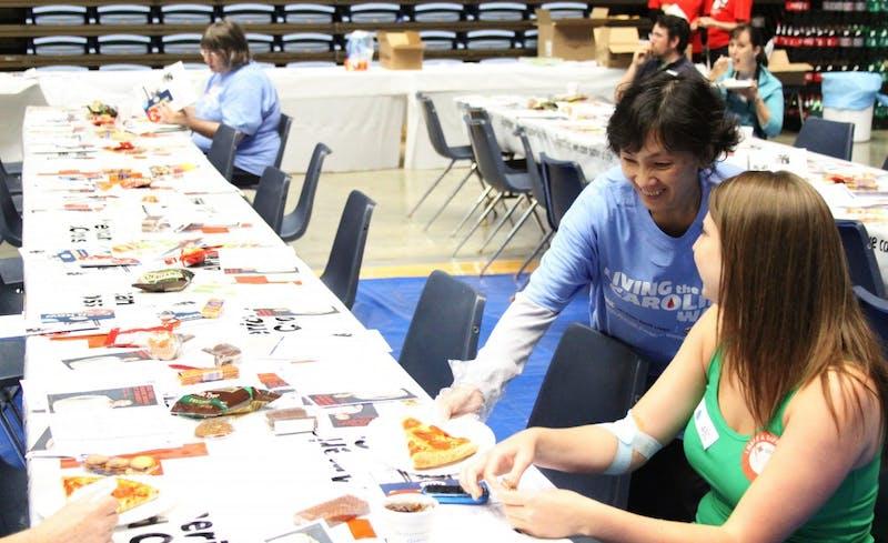 volunteer Debbie Quach, donor rising Senior Kati LeMay