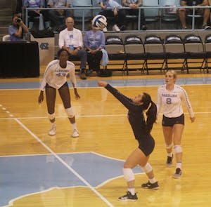 Libero Mia Fradenburg (13) passes the ball during Friday's game against Boston College.