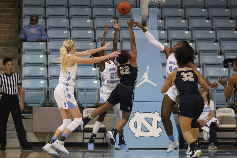UNC players attemp to block the ball during exhibiton game against Wingate in the Charmichael Arena on Saturday, Nov. 2, 2019. UNC won 82-37.