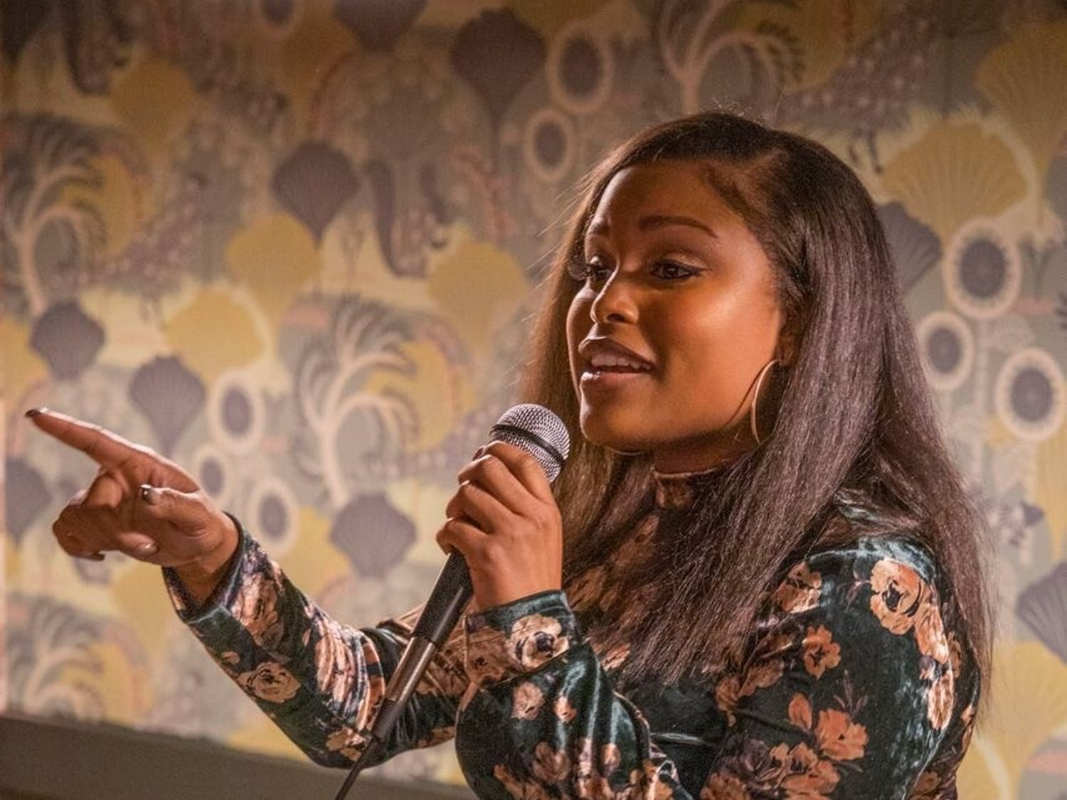 Senior Tyla Gomez performs at the bitter/sweet comedy show at Epilogue Books Chocolate Brews on Thursday, Nov. 14, 2019.