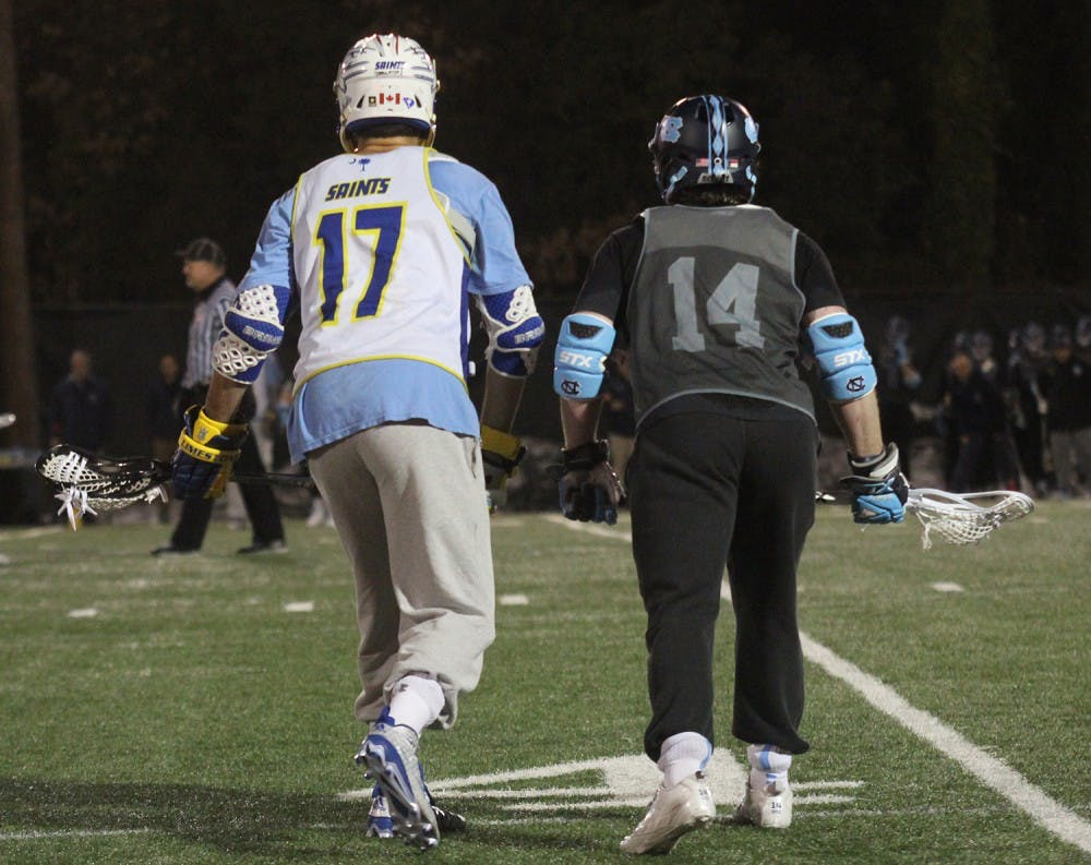 The men's lacrosse team scrimmaged Limestone on Thursday night, Jan. 28. So. William McBride (14) prepares to fight for the ball.