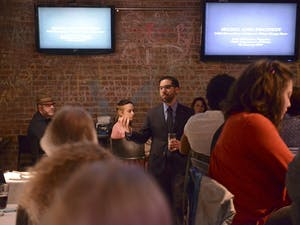 Michael Figueroa, an ethnomusicologist, gives a speech at the Humanities Happy Hour: Protest Music event on Wednesday night at Top of the Hill.