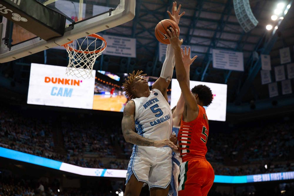 First-year forward Armando Bacot (5) attempts to block a free throw from UM's first-year guard Harlond Beverly (5) in the Smith Center on Saturday, Jan. 25, 2020. UNC defeated Miami 94-71.
