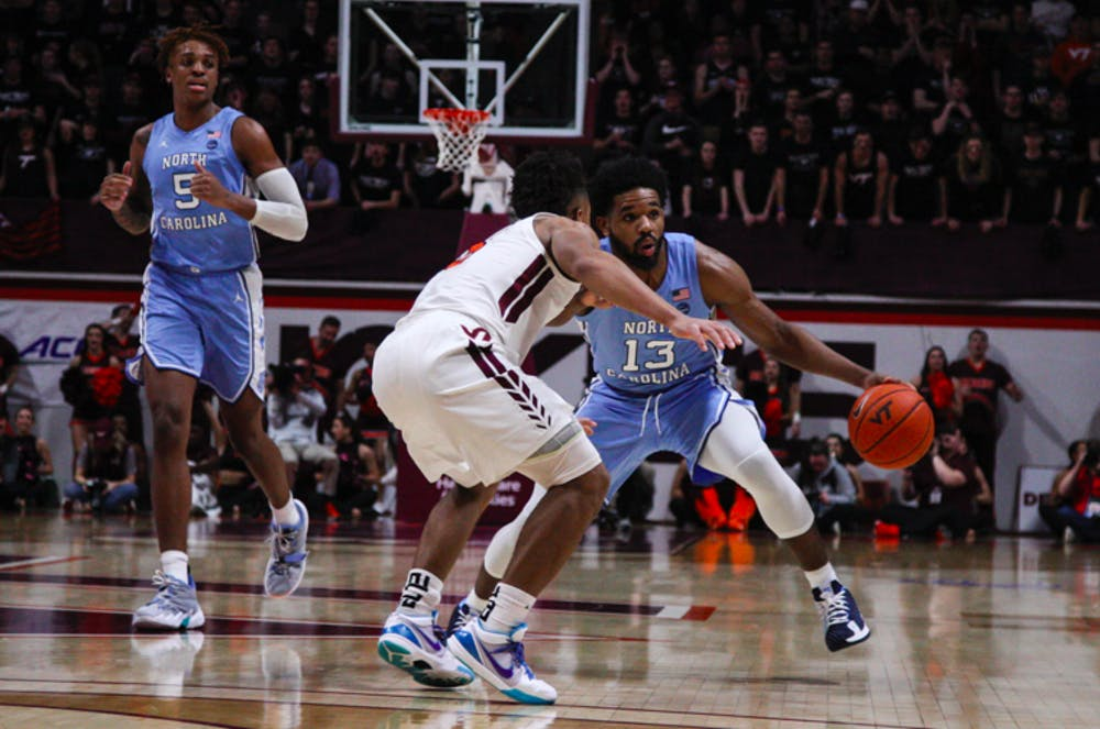 <p>UNC first-year guard Jeremiah Francis (13) dribbles the ball in a game against Virginia Tech at Cassell Coliseum on Wednesday, Jan. 22, 2020.&nbsp;</p>