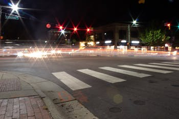 Traffic on the corner of East Franklin Street and North Columbia street leaves trails of light on Sunday, Oct. 6, 2019.