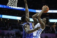 Duke first-year forward Zion Williamson (1) attempts to block a layup by UNC first-year forward Nassir Little (5) during the semifinals of the ACC Tournament at the Spectrum Center in Charlotte, N.C. on Friday, March 15, 2019. UNC fell to Duke 73-74.