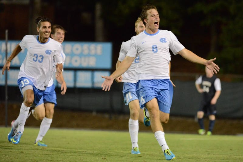 UNC forward Tyler Engel (8) celebrates after scoring the game winning goal in the second overtime period.