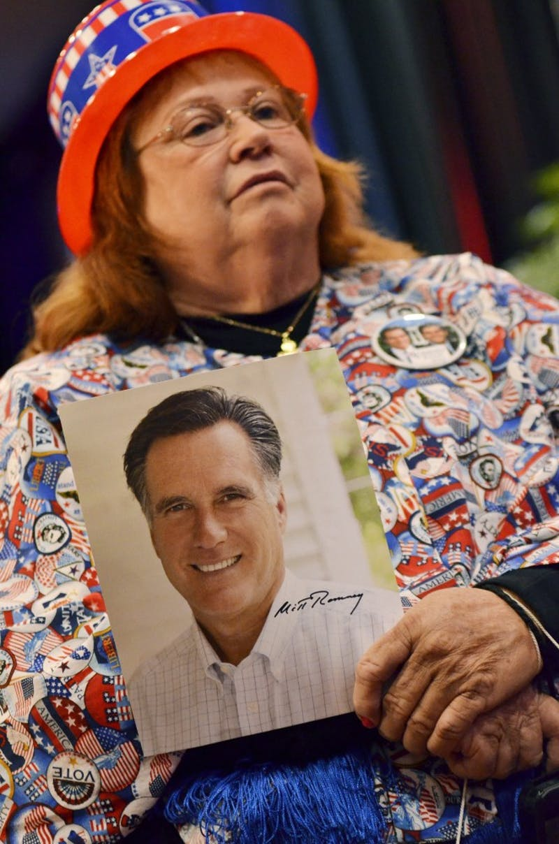 Lee Churchill seen holding a Romney photograph in her home made shirt.