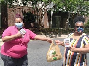 Volunteers Lorie Clark and Letitia Davison distributed masks at Carolina Spring Senior Apartments in Carrboro. Photo courtesy of Catherine Lazorko.