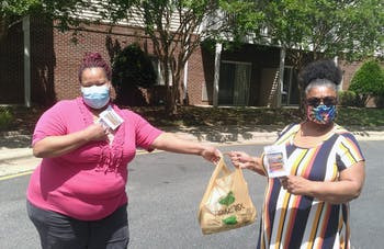 Volunteers Lorie Clark and Letitia Davison distributed masks at Carolina Spring Senior Apartments in Carrboro. Photo courtesy of Catherine Lazorko.