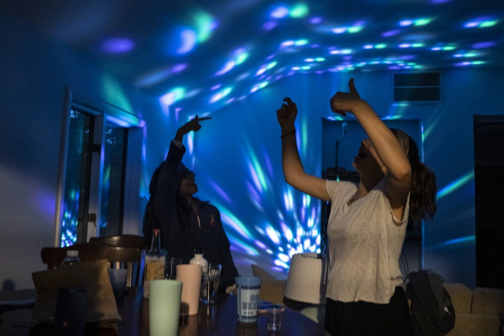 DTH Photo Illustration of students partying in an off-campus house. Governor Roy Cooper made an executive order prohibiting indoor gatherings of over 10 people, an order that several groups of students have already been cited for.