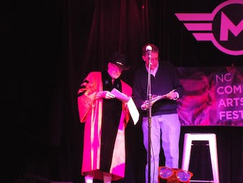 George Gopen (left) and Tom Campbell hosting the Great Durham Pun Championship last year at Motorco Music Hall. Photo courtesy of Barbara Porter.