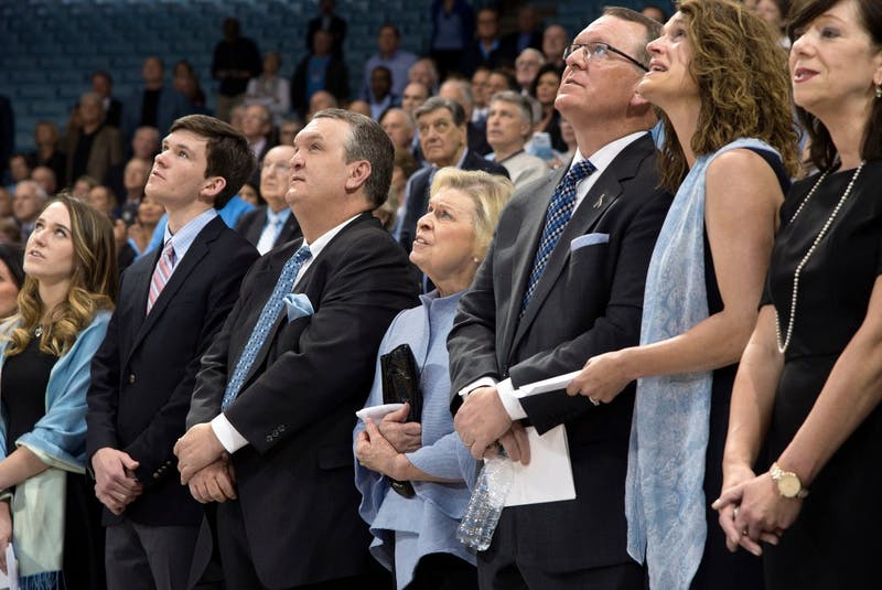 """Woody Durham's family sings """"Carolina In My Mind"""" during a service on April 8 in Carmichael Arena. Photo courtesy of Jeffrey A. Camarati/UNC Athletics Communications."""