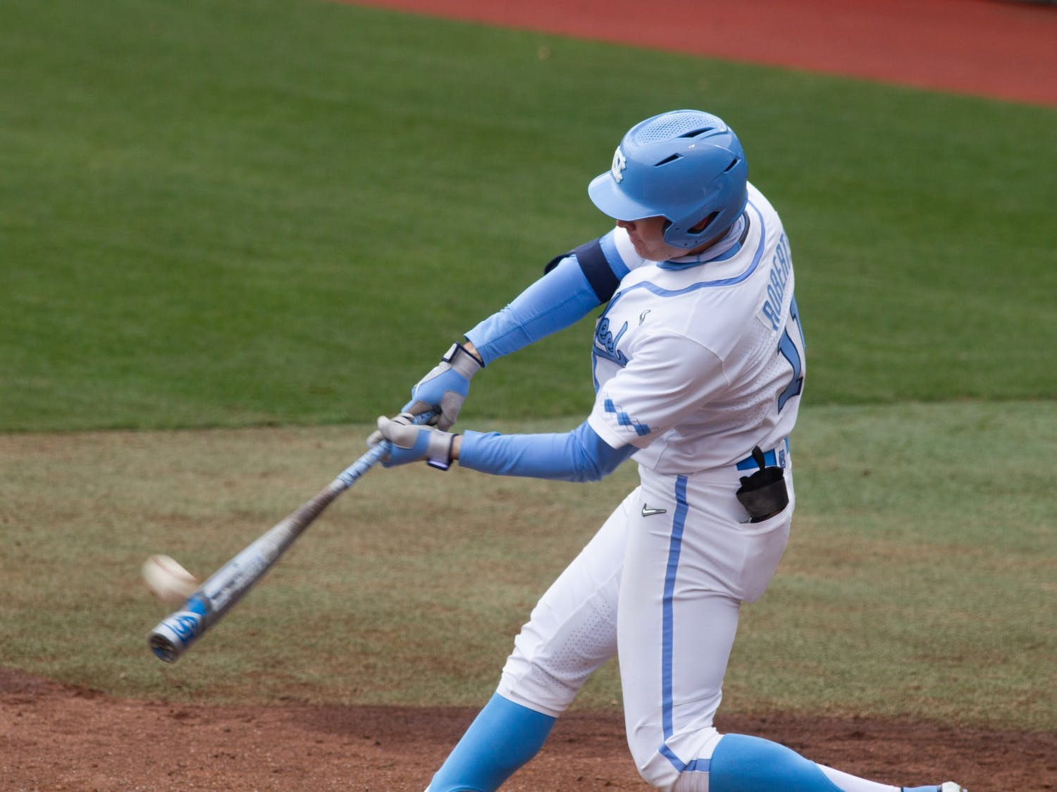 UNC sophomore outfielder Caleb Roberts hits his first of two home runs during Carolina's 8-1 season-opening victory over James Madison at Boshamer Stadium, Feb. 19, 2021.