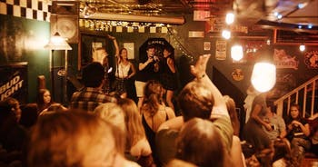 Participants sing at a previous cabaret at Linda's Bar and Grill. Photo courtesy of Matthew Keith.