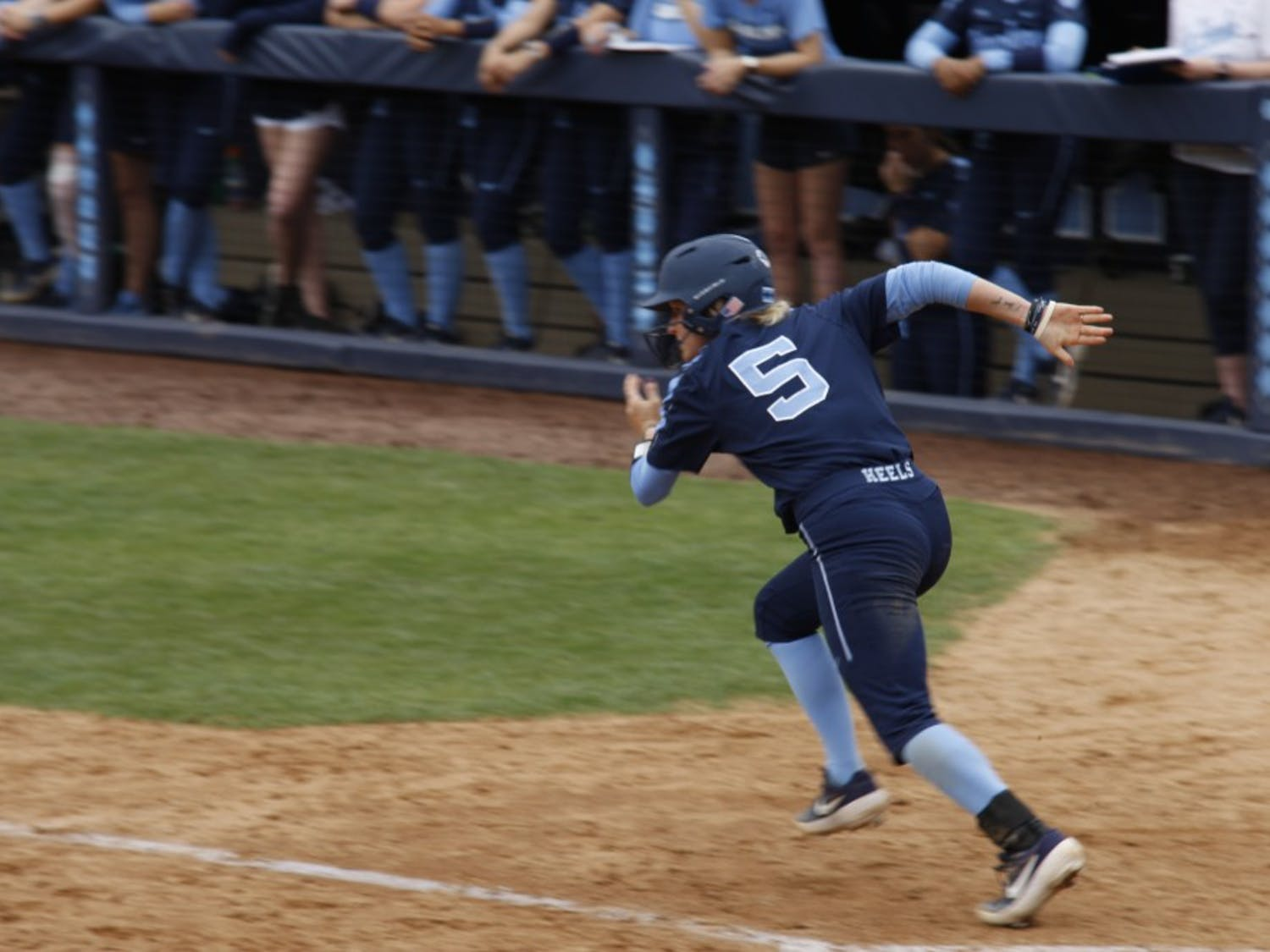 Junior first baseman Campbell Hutcherson (5) charges for first base during UNC's softball win against Virginia on Saturday, Apr. 6, 2019.
