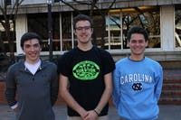 Zeke Parsons (Environmental Studies Major, middle), who started the Lettuce Club stands with two other members Brendan Gallagher (Mathematics Major, right) and Michael Bono (Business/Mathematical Decision Sciences Major, left).