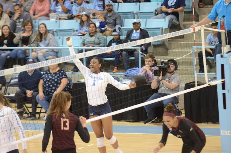First-year outside hitter Destiny Cox (1) celebrates after a successful kill during the Wednesday, Nov. 21, 2018 game against FSU. UNC lost the game 3-0.