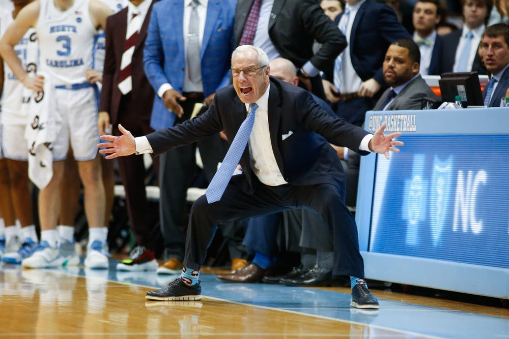 <p>Head Coach Roy Williams yells during a game against Pitt in the Smith Center on Wednesday, Jan. 8, 2020. The Tar Heels lost to the Panthers 65-73.</p>
