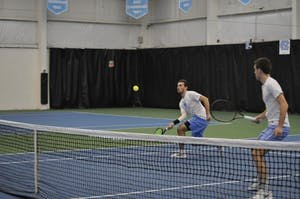Sophomore William Blumberg and senior Robert Kelly compete in doubles on March 2 at the Cone-Kenfield Tennis Center.