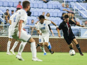 Raul Aguilera (28) tracks Hugh Chatman during a game versus Davidson in the UNC Soccer and Lacrosse Stadium on Tuesday, September 17th, 2019. The Tar Heels and the Wildcats tied 0-0.