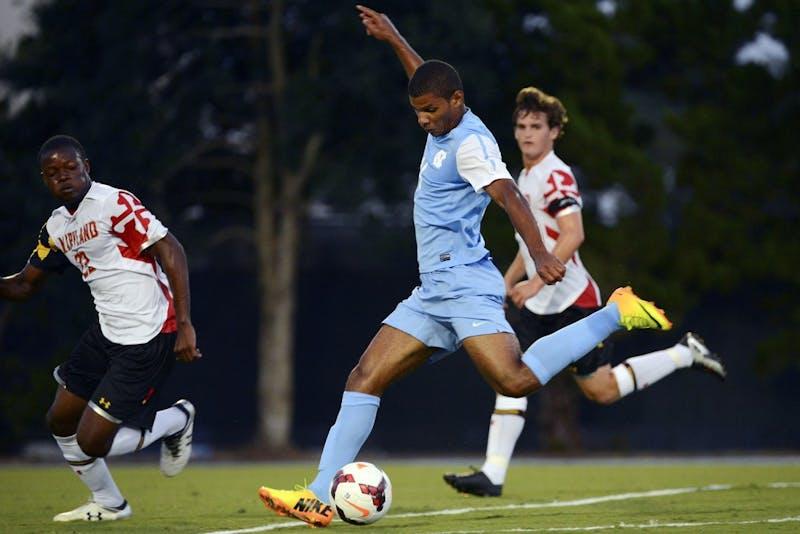 UNC midfielder Omar Holness (14) scores a goal.