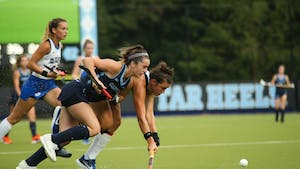 Erin Matson (1) races Duke player for ball in a game that UNC won 2-0, marking their 33rd consecutive victory.