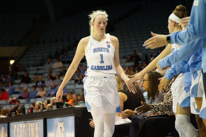 UNC senior guard Taylor Koenen (1) high-fives her teammates after the 3rd quarter during a game in Carmichael Arena on Thursday, Feb. 13, 2020. The Orange beat the Tar Heels 74-56.